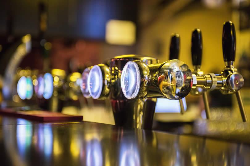 Metallic beer taps in English pub