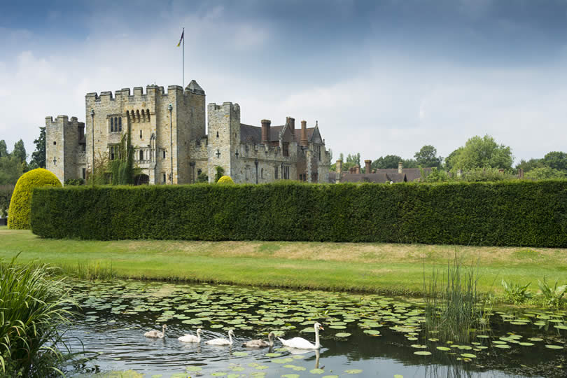 Swans in front of Hever Castle in Kent UK