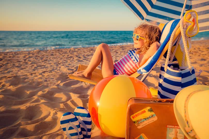 Kid sitting in beach chair