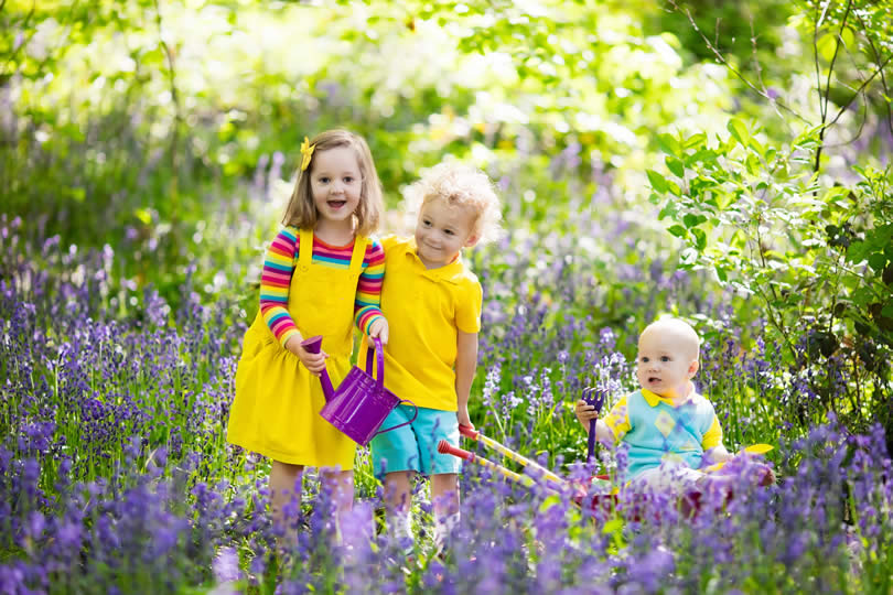 Kids in a park with flowers