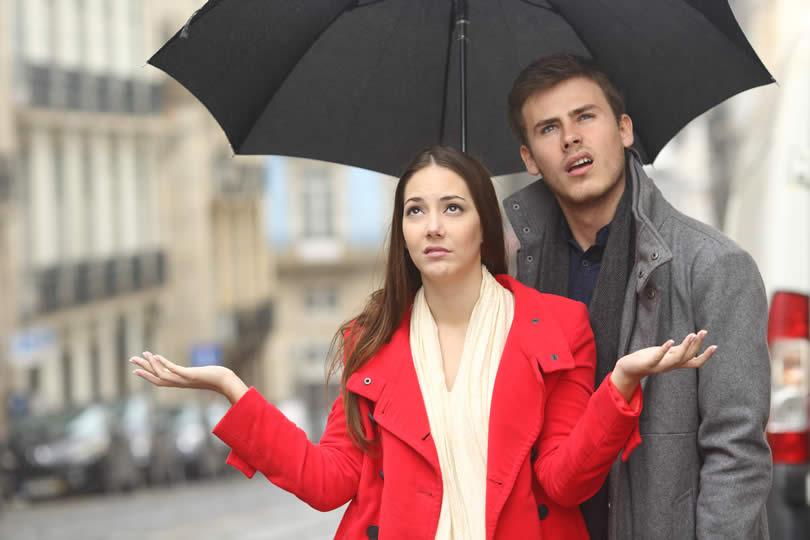 Couple with umbrella rainy day UK
