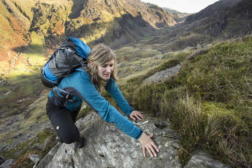 Woman hiking in Snowdonia Wales