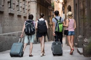 Tourists arriving in city with suitcases