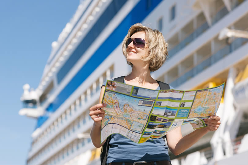 Woman with map on a cruise