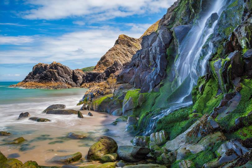 Tresaith Beach waterfall in West Wales