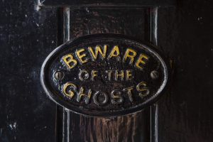Beware of the Ghosts door sign
