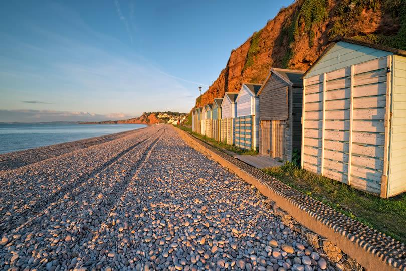 Beach huts facing the sea at Budleigh Salterton