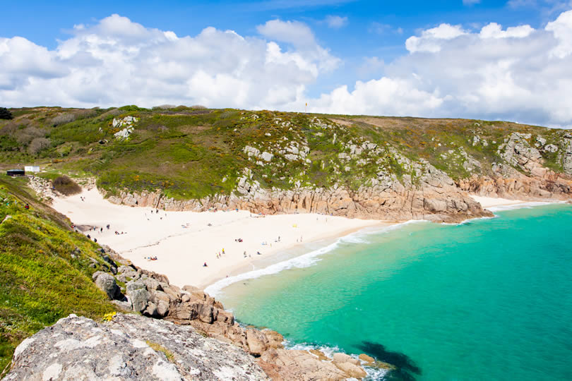 Sandy white beach of Porthcurno