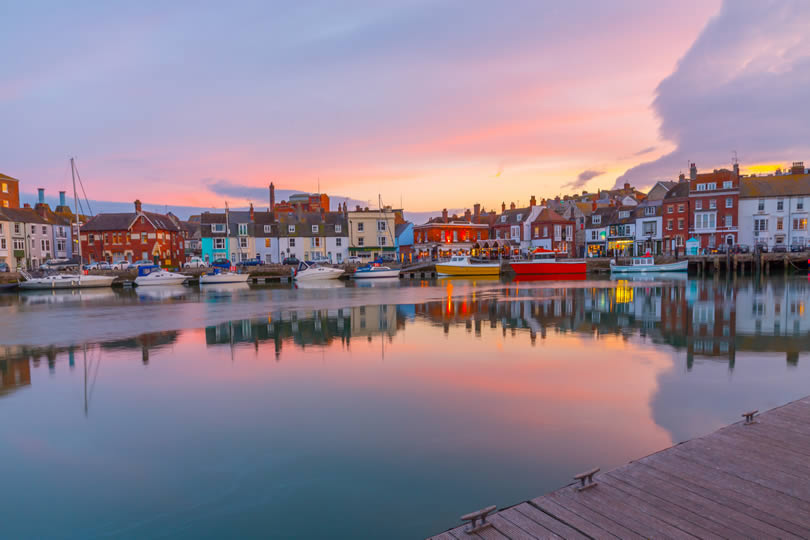 Fishing harbour of Weymouth at sunset
